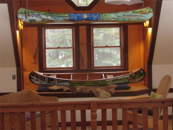 Two painted canoes.