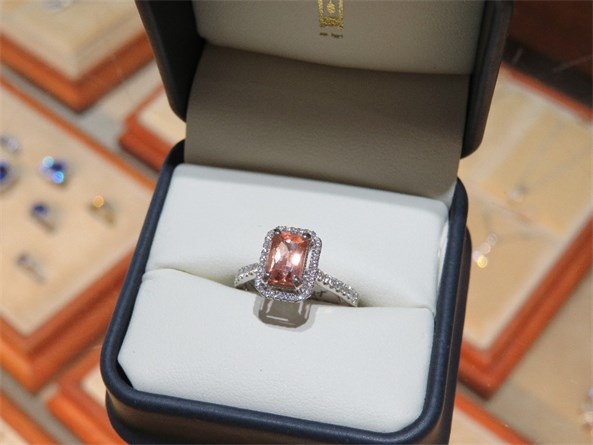 Precious Topaz and Diamond Halo Ring