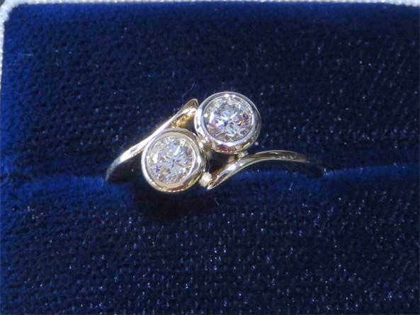 Round Brilliant Two Bezel set Diamond Bypass Ring