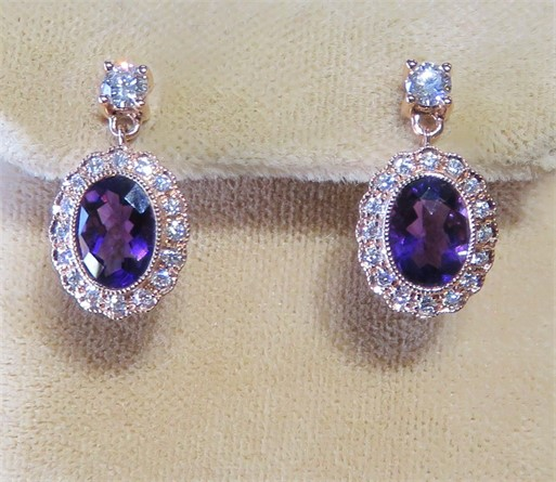 Oval Amethyst and Diamond Earrings.